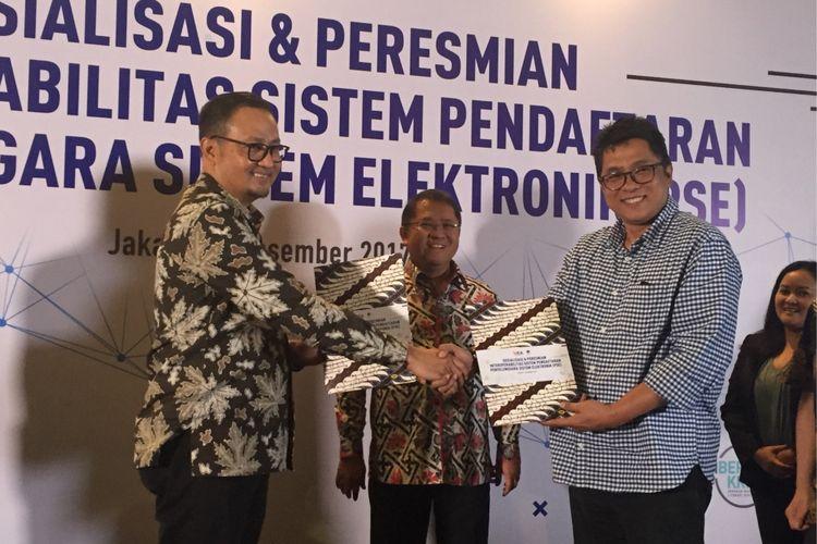 Suasana perjanjian kerja sama Kementerian Komunikasi dan Informatika dengan Asosiasi E-Commerce Indonesia (idEA) untuk layanan pendaftaran sistem elektronik (PSE) di hotel Aston Kuningan Suites, Jakarta Selatan, Kamis (7/12/2017). Turut serta Menteri Kominfo Rudiantara dan Ketua Umum idEA Aulia E Marinto.