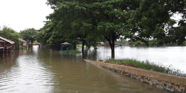 Banjir di daerah Rawa Bulakan, Kota Tangerang, Selasa (1/3/2016).