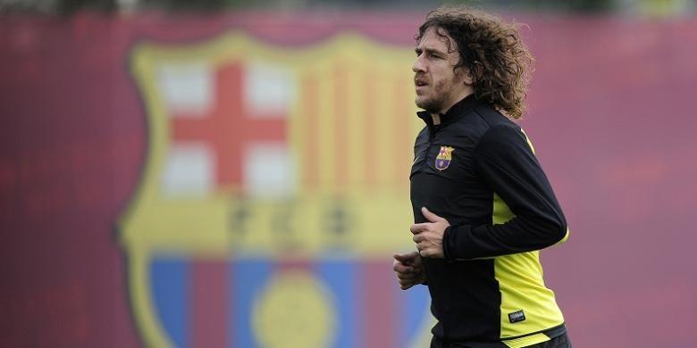 Mantan kapten Barcelona, Carles Puyol, kala masih aktif berkarier sebagai pesepak bola. Puyol gantung sepatu pada akhir musim 2013-2014.
