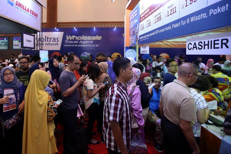 Suasana Garuda Indonesia Travel Fair 2017 di Jakarta Convention Center, Jumat (22/9/2017). Acara yang berlangsung hingga 24 September mendatang memberikan berbagai promo tiket, hotel, dan wisata.