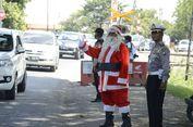 Bantu Urai Kemacetan Libur Natal di Madiun, Sinterklas Turun ke Jalan