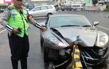 Penanganan Mobil James Bond yang Ringsek di Harmoni