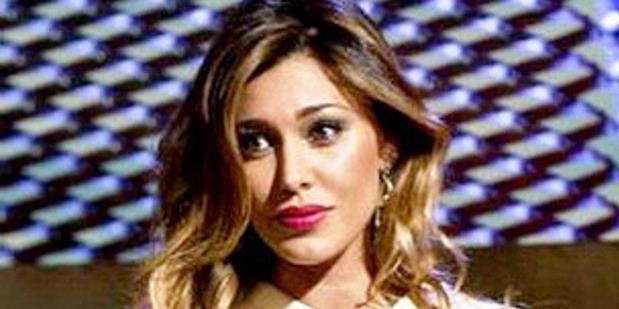 0729307 penyiar televisi italia 620X310 Wanita Seksi di TV Italia Akan Dipangkas