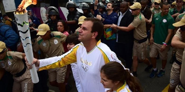 Protes Warnai Kedatangan Obor Olimpiade Di Rio De Janeiro