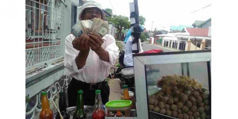 Pedagang mata uang asing